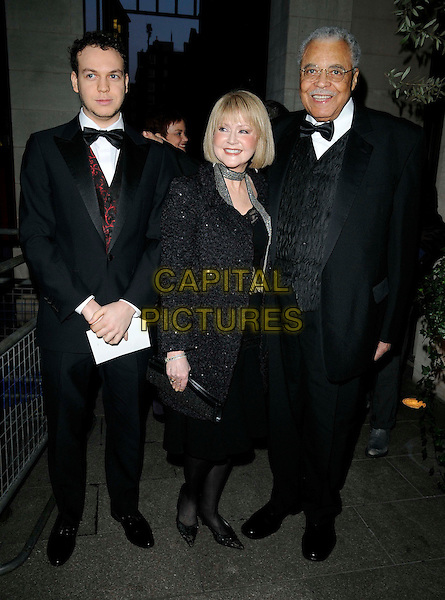FLYNN EARL JONES (?), CECILIA HART & JAMES EARL JONES.The Laurence Olivier Awards 2010, Grosvenor House Hotel, London, England. .21st March 2010.full length black tuxedo  dress coat jacket son father dad family married husband wife .CAP/CAN.©Can Nguyen/Capital Pictures.