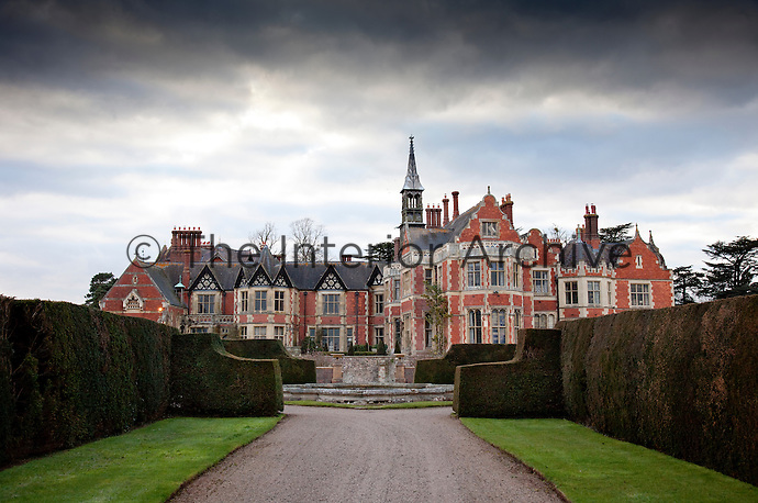 Madresfield Court, a 19th century 'Elizabethan' manor, with brick walls and timber framed gables topped with delicate finials