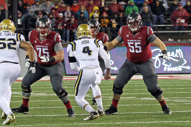 B.J. Salmonson (75) and Noah Osur-Myers (55) block for Kyle Sweet (17) during the Washington State Cougars Pac-12 Conference victory over the UCLA Bruins, 27-21, on October 15, 2016, at Martin Stadium in Pullman, Washington.