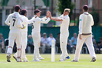Sam Curran of Surrey is congratulated by his team mates after taking the wicket of Neil Wagner during Surrey CCC vs Essex CCC, Specsavers County Championship Division 1 Cricket at Guildford CC, The Sports Ground on 11th June 2017