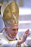 Pope Benedict XVI waves as he leaves after celebrating a mass to mark the World Day of Peace in Saint Peter's Basilica at the Vatican January 1, 2008