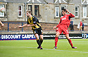 Raith's Brian Graham (9) heads home Raith's first.