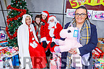 Rebecca Coffey the driving force behind the Toy Appeal in Manor West Shopping Centre on Saturday for the the donation of toys for the University hospital children's ward and the Adapt Women's refuge. Standing with Fiona Dunne, Santa Claus, Millie and Liz Sheehan