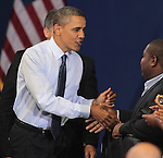 U.S. President Barack Obama greets supporters during a town hall meeting at Ritchie Coliseum on the campus of the University of Maryland in College Park, Maryland July 22, 2011..Copyright EML/Rockinexposures.com.