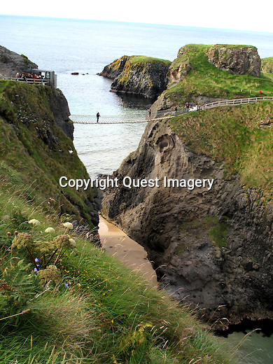 Carrick-a-Rede Rope Bridge is a famous rope bridge near Ballintoy in County Antrim, Northern Ireland. The bridge links the mainland to the tiny island of Carrickarede. It spans 20 metres and is 30 metres above the rocks below. <br />