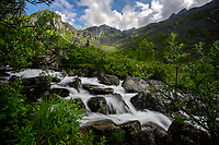 A mountain stream creates small waterfalls along Reed Lakes Trail in Alaska's Talkeetna Mountains.