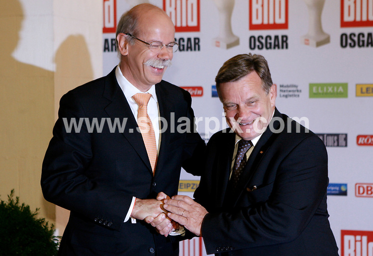 **ALL ROUND PICTURES FROM SOLARPIX.COM**.**SYNDICATION RIGHTS FOR UK AND SPAIN ONLY**.The German newspaper 'Bild' allocates media award Osgar since 1994 people who worked for peace and freedom and for the coalescence of Germany..This pic:Daimler CEO Dieter Zetsche (L) and Deutschen Bahn CEO Hartmut Mehdorn.JOB REF:6715-CPR/Sebastian Willnow  DATE:24_06_08.**MUST CREDIT SOLARPIX.COM OR DOUBLE FEE WILL BE CHARGED* *UNDER NO CIRCUMSTANCES IS THIS IMAGE TO BE REPRODUCED FOR ANY ONLINE EDITION WITHOUT PRIOR PERMISSION*