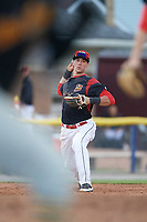 Batavia Muckdogs third baseman Tyler Curtis (11) throws to first base during a game against the West Virginia Black Bears on June 26, 2017 at Dwyer Stadium in Batavia, New York.  Batavia defeated West Virginia 1-0 in ten innings.  (Mike Janes/Four Seam Images)
