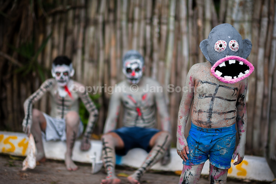 Salvadoran boys, painted an ashen grey and wearing masks, perform indigenous mythology characters in the La Calabiuza parade at the Day of the Dead celebration in Tonacatepeque, El Salvador, 1 November 2016. The festival, known as La Calabiuza since the 90s of the last century, joins Salvador's pre-Hispanic heritage and the mythological figures (La Sihuanaba, El Cipitío, La Llorona etc.) collected from the whole Central American region, together with the catholic All Saints Day holiday and its tradition of honoring the dead relatives. Children and youths only, dressed up in scary costumes and carrying painted carts, march from the local cemetery to the downtown plaza where the party culminates with music, dance, drinking and eating pumpkin (Ayote) with honey.