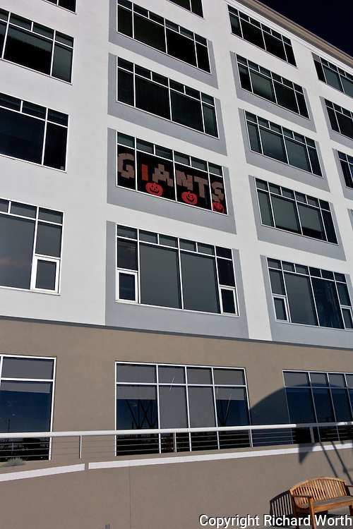 """Sheets of paper spell out """"Giants"""" in an office window adjacent to AT&T Park, in the morning before the Giants won the 2010 World Series."""