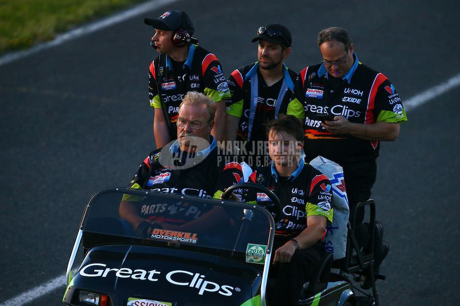 Jun 10, 2016; Englishtown, NJ, USA; Crew members for NHRA top fuel driver Clay Millican during qualifying for the Summernationals at Old Bridge Township Raceway Park. Mandatory Credit: Mark J. Rebilas-USA TODAY Sports