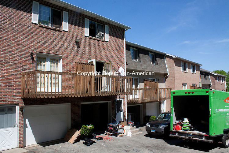 WATERBURY, CT- MAY 17  2011-051712DA10- Official clean up Thursday after a fatal fire at a Bucks Hill Road condominium complex Wednesday evening..Darlene Douty Republican American