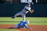 Kentucky Wildcats second baseman Riley Mahan (2) turns a double play as Brandon Martorano (4) of the North Carolina Tar Heels slides into second base at Boshmer Stadium on February 17, 2017 in Chapel Hill, North Carolina.  The Tar Heels defeated the Wildcats 3-1.  (Brian Westerholt/Four Seam Images)