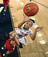 CHARLOTTESVILLE, VA- December 7: Ataira Franklin #23 of the Virginia Cavaliers shoots over Reagan Miller #5 of the Liberty Lady Flames during the game on December 7, 2011 at the John Paul Jones arena in Charlottesville, Va. Virginia defeated Liberty 64-38. (Photo by Andrew Shurtleff/Getty Images) *** Local Caption *** Reagan Miller;Ataira Franklin