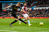 12th January 2020; Villa Park, Birmingham, Midlands, England; English Premier League Football, Aston Villa versus Manchester City; Kevin De Bruyne of Manchester City takes a shot at goal as El Mohamady of Villa closes in - Strictly Editorial Use Only. No use with unauthorized audio, video, data, fixture lists, club/league logos or 'live' services. Online in-match use limited to 120 images, no video emulation. No use in betting, games or single club/league/player publications