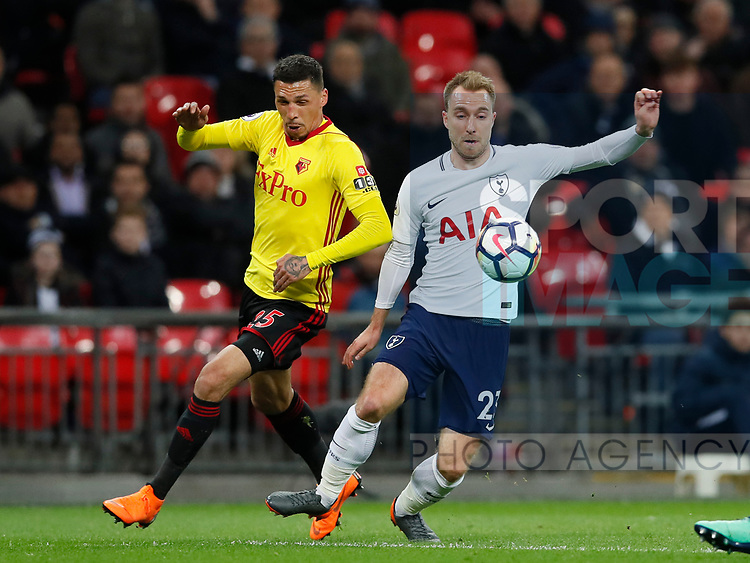 Jose Holebas of Watford challenges Christian Eriksen of Tottenham during the premier league match at Wembley Stadium, London. Picture date 30th April 2018. Picture credit should read: David Klein/Sportimage