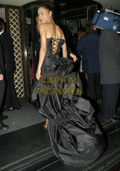 SOPHIE OKONEDO.Official BAFTA Aftershow Dinner Party, .Grosvenor House, Park lane, London, .February 12th 2005..full length strapless black dress corset top lace up back behind rear.Ref: AH.www.capitalpictures.com.sales@capitalpictures.com.©Capital Pictures.