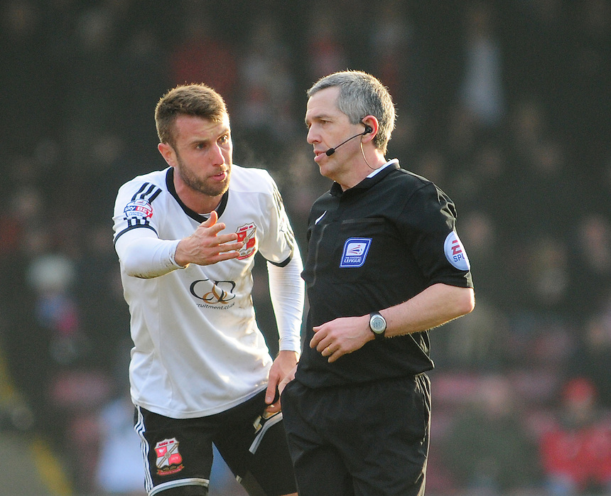 Swindon Town's Andy Williams speaks to Referee Frederick Graham before he is booked for diving<br /> <br /> Photographer Chris Vaughan/CameraSport<br /> <br /> Football - The Football League Sky Bet League One - Scunthorpe United v Swindon Town - Saturday 14th February 2015 - Glanford Park - Scunthorpe<br /> <br /> &copy; CameraSport - 43 Linden Ave. Countesthorpe. Leicester. England. LE8 5PG - Tel: +44 (0) 116 277 4147 - admin@camerasport.com - www.camerasport.com