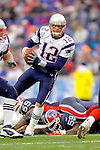 New England Patriots quarterback Tom Brady dances around defensive pressure as he looks to make a pass against the Buffalo Bills at Ralph Wilson Stadium in Orchard Park, NY, on December 11, 2005 . The Patriots defeated the Bills 35-7. Mandatory Photo Credit: Ed Wolfstein