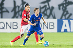 Jaimes Anthony McKee (r) of Eastern SC fights for the ball with Feng Xiaoting of Guangzhou Evergrande FC during their AFC Champions League 2017 Match Day 1 Group G match between Guangzhou Evergrande FC (CHN) and Eastern SC (HKG) at the Tianhe Stadium on 22 February 2017 in Guangzhou, China. Photo by Victor Fraile / Power Sport Images
