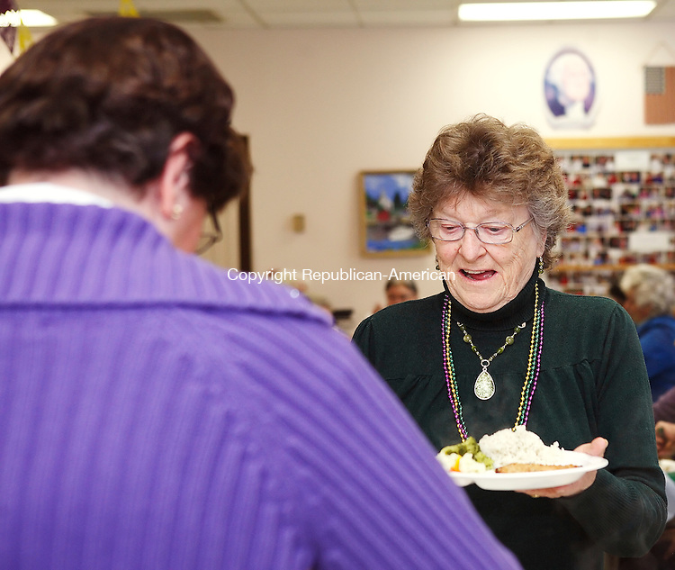 Winsted, CT-17, February 2010-021710CM08  Yvonne Gilley (right) of Winsted receives lunch from Janice Deneare (left) of Winsted, Wednesday afternoon at the Blanche McCarthy Winsted Senior Center. A Mardis Gras lunch was held to celebrate Fat Tuesday (which was postponed from Tuesday's snow storm.)  Pork chops, rice, apple sauce and mixed vegetables were on the menu.    --Christopher Massa Republican-American