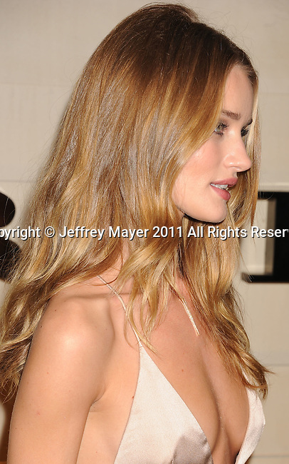 "BEVERLY HILLS, CA - OCTOBER 26: Rosie Huntington-Whiteley  arrives at the launch of Burberry's new fragrance ""Burberry Body"" at Burberry on October 26, 2011 in Beverly Hills, California."