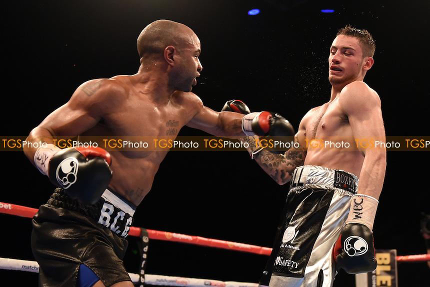 Carson Jones (black shorts) defeats Ben Hall during a Boxing Show at the SSE Arena, Wembley on 26th November 2016