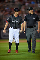Reading Fightin Phils manager Shawn Williams (22) argues a home run being overturned call with umpire Jacob Metz during an Eastern League game against the Trenton Thunder on August 16, 2019 at FirstEnergy Stadium in Reading, Pennsylvania.  Trenton defeated Reading 7-5.  (Mike Janes/Four Seam Images)