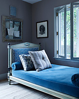 In the study, the headboard of the directoire daybed is upholstered in a linen by Chelsea Textiles, with a cushion and bolsters in a mohair by Clarence House; the abstract painting is by Santiago Castillo, and the walls are painted in Farrow & Ball's Charleston Gray.