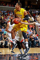 CHARLOTTESVILLE, VA- NOVEMBER 29: Jordan Morgan #52 of the Michigan Wolverines handles the ball during the game on November 29, 2011 at the John Paul Jones Arena in Charlottesville, Virginia. Virginia defeated Michigan 70-58. (Photo by Andrew Shurtleff/Getty Images) *** Local Caption *** Jordan Morgan