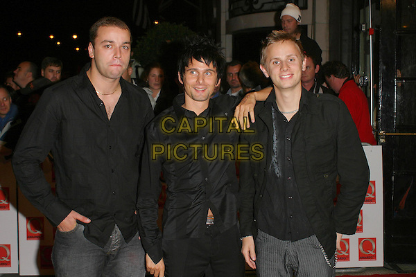 MUSE.The 2003 Q Awards, Park Lane Hotel, London, UK.2nd October 2003 .half length, half-length.www.capitalpictures.com.sales@capitalpictures.com.Supplied By Capital PIctures