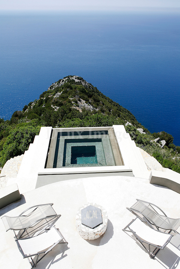 This island home in Kefalonia, Greece is built  at the top of a gorge, overlooking two of the most beautiful beaches in the Mediterranean.