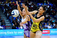Mila Reuelu-Buchanan (left) and Karin Burger compete for the ball during the ANZ Premiership netball match between the Central Pulse and Northern Stars at Te Rauparaha Arena in Wellington, New Zealand on Wednesday, 3 April 2019. Photo: Dave Lintott / lintottphoto.co.nz