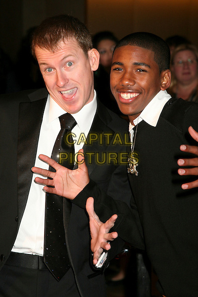 RON CLARK & BRANDON SMITH.The 8th Annual Family Television Awards at the Beverly Hilton Hotel, Beverly Hills, California, USA..November 29th, 2006.headshot portrait skull crossbones necklace silver black mouth open hand palm.CAP/ADM/BP.©Byron Purvis/AdMedia/Capital Pictures