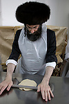 Israel, Bnei Brak. Passover at the Premishlan congregation, the Motzot baking on Passover eve, preparing the dough, 2005<br />