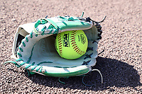DURHAM, NC - FEBRUARY 29: An NCAA softball in a softball glove during a game between Notre Dame and Duke at Duke Softball Stadium on February 29, 2020 in Durham, North Carolina.