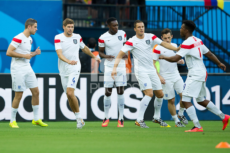 Steven Gerrard of England warms up with his team mates
