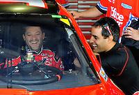 Oct. 10, 2009; Fontana, CA, USA; NASCAR Sprint Cup Series driver Juan Pablo Montoya (right) talks with Tony Stewart during practice for the Pepsi 500 at Auto Club Speedway. Mandatory Credit: Mark J. Rebilas-