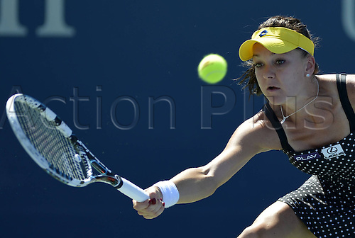 25.08.2014. Flushing Meadows, NY, USA.  Agnieszka Radwanska of Poland competes during for women s singles 1st round match against Sharon Fichman of Canada at the U.S. Open tennis tournament in New York, the United States, on Aug. 25, 2014. Agnieszka Radwanska won 2-0.