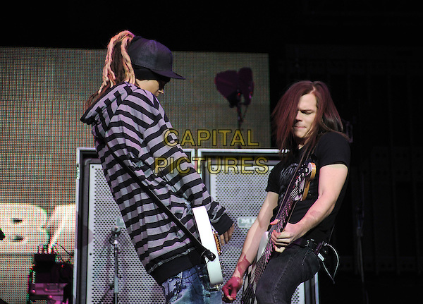 TOKIO HOTEL .live at The102.7's KIIS-FM's Jingle Ball 08 held at The Honda Center in Anaheim, California, USA, .December 6th 2008                                                                     .music gig on stage half length striped top cap hat guitar jeans  black purple .CAP/DVS.©Debbie VanStory/Capital Pictures