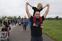 NWA Democrat-Gazette/CHARLIE KAIJO Rodney Barnes of Cave Springs holds up Rhett Barnes, 3, during the Autism Involves Me annual walk, Saturday, May 4, 2019 at the Benton County Fairgrounds in Bentonville. <br /><br />Autism Involves Me, a Bentonville non-profit, held its annual walk to highlight the lack of services for kids with autism.