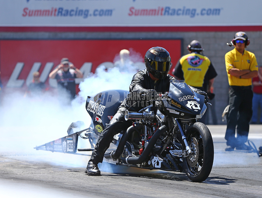 Apr 11, 2015; Las Vegas, NV, USA; NHRA top fuel Harley rider Len Darnell Jr during qualifying for the Summitracing.com Nationals at The Strip at Las Vegas Motor Speedway. Mandatory Credit: Mark J. Rebilas-