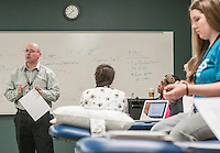 NWA Democrat-Gazette/ANTHONY REYES • @NWATONYR<br /> Dr. David Taylor, Associate Professor of Physical Therapy at University of Arkansas for Medical Sciences, reviews some course material and testing procedures Thursday, Dec. 10, 2015 at the school in Fayetteville. The students were in a lab reviewing course material for their upcoming final exams. The school is finishing its first semester in Fayetteville.