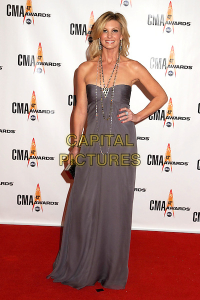 FAITH HILL.43rd Annual CMA Awards, Country Music's Biggest Night, held at the Sommet Center, Nashville, Tennessee, USA..November 11th, 2009.full length purple strapless dress hand on hip silver necklaces .CAP/ADM/LF.©Laura Farr/AdMedia/Capital Pictures.