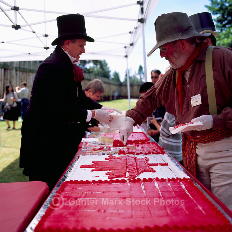 Fort Langley National Historic Site, BC, British Columbia, Canada - Volunteers cutting Giant Birthday Cakes at Canada Day Celebrations