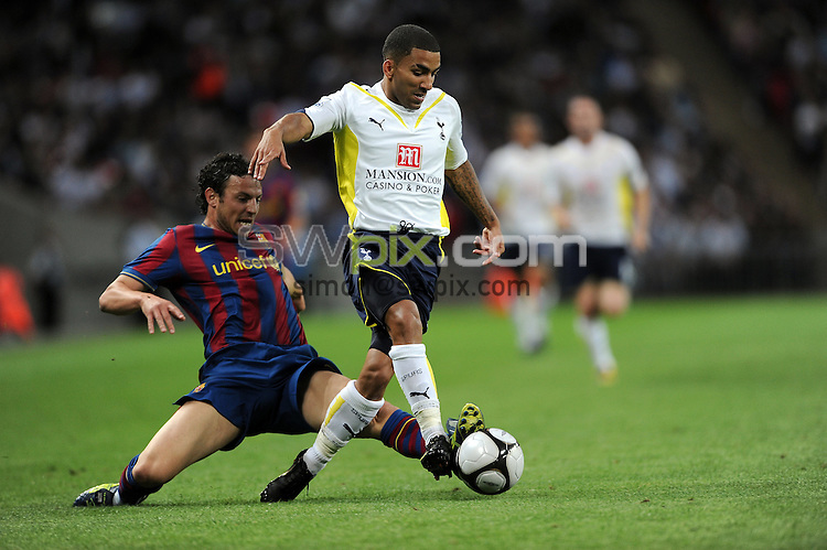 PICTURE BY JEREMY RATA/SWPIX.COM. Wembley Cup - Tottenham Hotspur v FC Barcelona, Wembley Stadium, London, England. 24th July 2009. Spur's Aaron Lennon is tackled by Barca's Eduard Oriol..Copyright - Simon Wilkinson - 07811267706