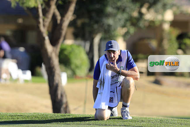 Caddy John Mclaren at the 16th green during Saturday's Round 3 of the 2017 CareerBuilder Challenge held at PGA West, La Quinta, Palm Springs, California, USA.<br /> 21st January 2017.<br /> Picture: Eoin Clarke | Golffile<br /> <br /> <br /> All photos usage must carry mandatory copyright credit (&copy; Golffile | Eoin Clarke)