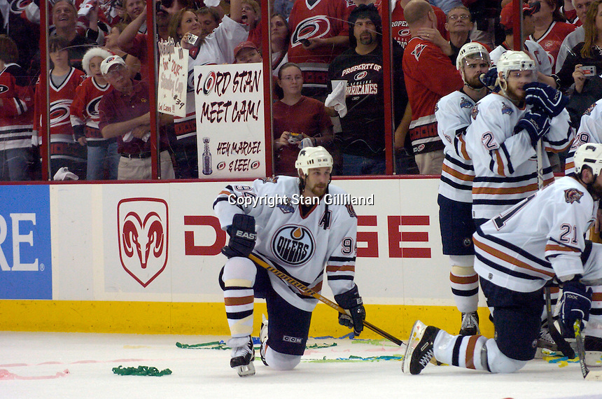 Ryan Smyth of the Edmonton Oilers, center, watches the Carolina Hurricanes celebrate a 3-1 victory in game seven to take the Stanley Cup at the RBC Center in Raleigh, NC Monday, June 19, 2006.