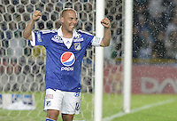 BOGOTÁ -COLOMBIA, 15-06-2013. Mayer Candelo de Millonarios celebra un gol  de Wason Renteria en contra de Once Caldas durante partido de los cuadrangulares finales F1 de la Liga Postobón 2013-1 jugado en el estadio el Campín de la ciudad de Bogotá./ Mayer Candelo of Millonarios celebrates a goal from Wason renteria against Once Caldas during match of the final quadrangular 1th date of Postobon  League 2013-1 at El Campin stadium in Bogotá city. Photo: VizzorImage/STR