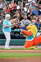The Famous San Diego Chicken dances with a fan for an on field promotion during a game between the Indianapolis Indians and Rochester Red Wings on July 26, 2014 at Frontier Field in Rochester, New  York.  Rochester defeated Indianapolis 1-0.  (Mike Janes/Four Seam Images)